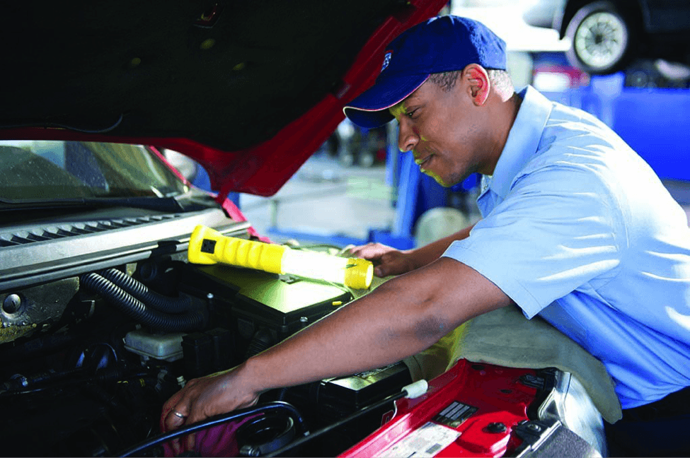 Aamco franchise worker fixing the transmission on a car